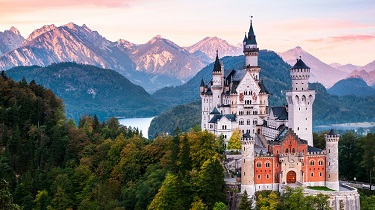 A lush alpine landscape surrounds Germany's iconic Neuschwanstein Castle.
