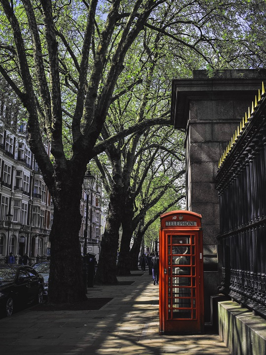 Red telephone booth on London street