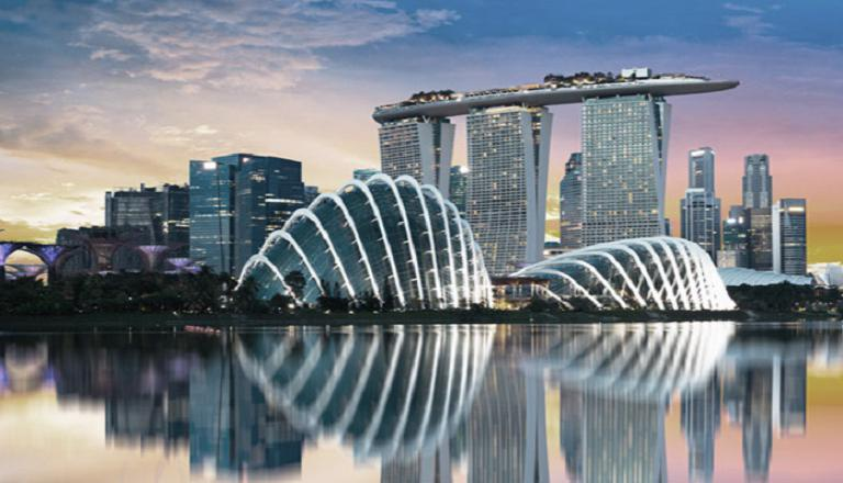 The stunning architecture of downtown Singapore casts a dazzling reflection in the city's harbor.
