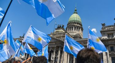People waving Argentina's flags