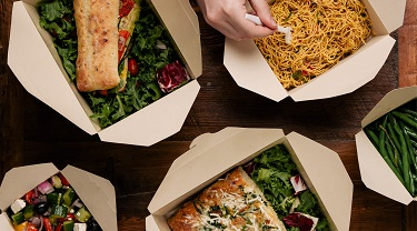 Variety of foods in takeout boxes