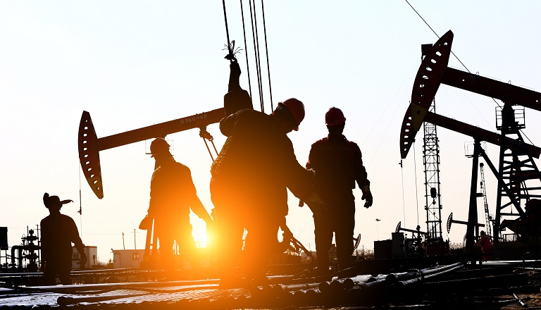 Oil workers work on oil-patch rig