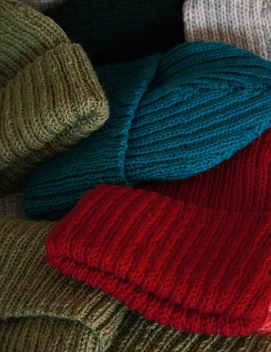 An array of wool hats are ready for shipping.