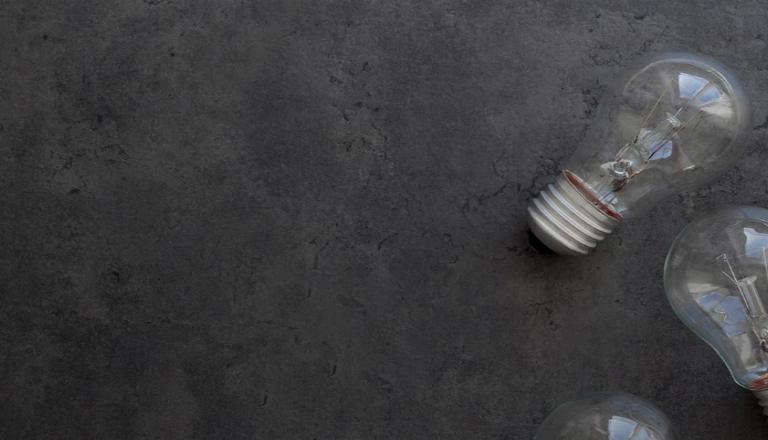 White lightbulb as a metaphor for ideas as intellectual property assets and the need to protect ideas