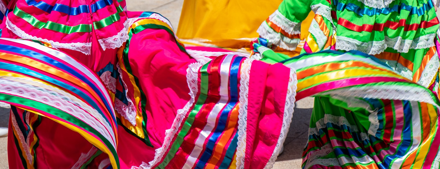 Colourful skirts twirl in a local marketplace.