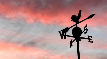 Weathervane in a red sky