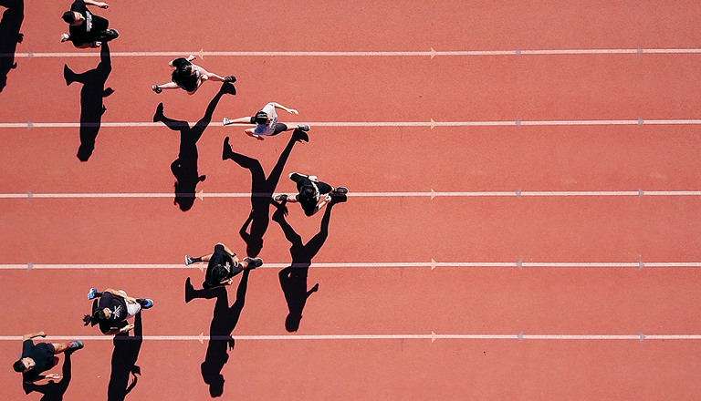 Viewed from above, athletes run on a track in a V formation.
