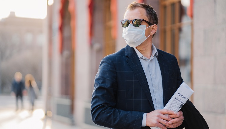 British businessman wears face mask