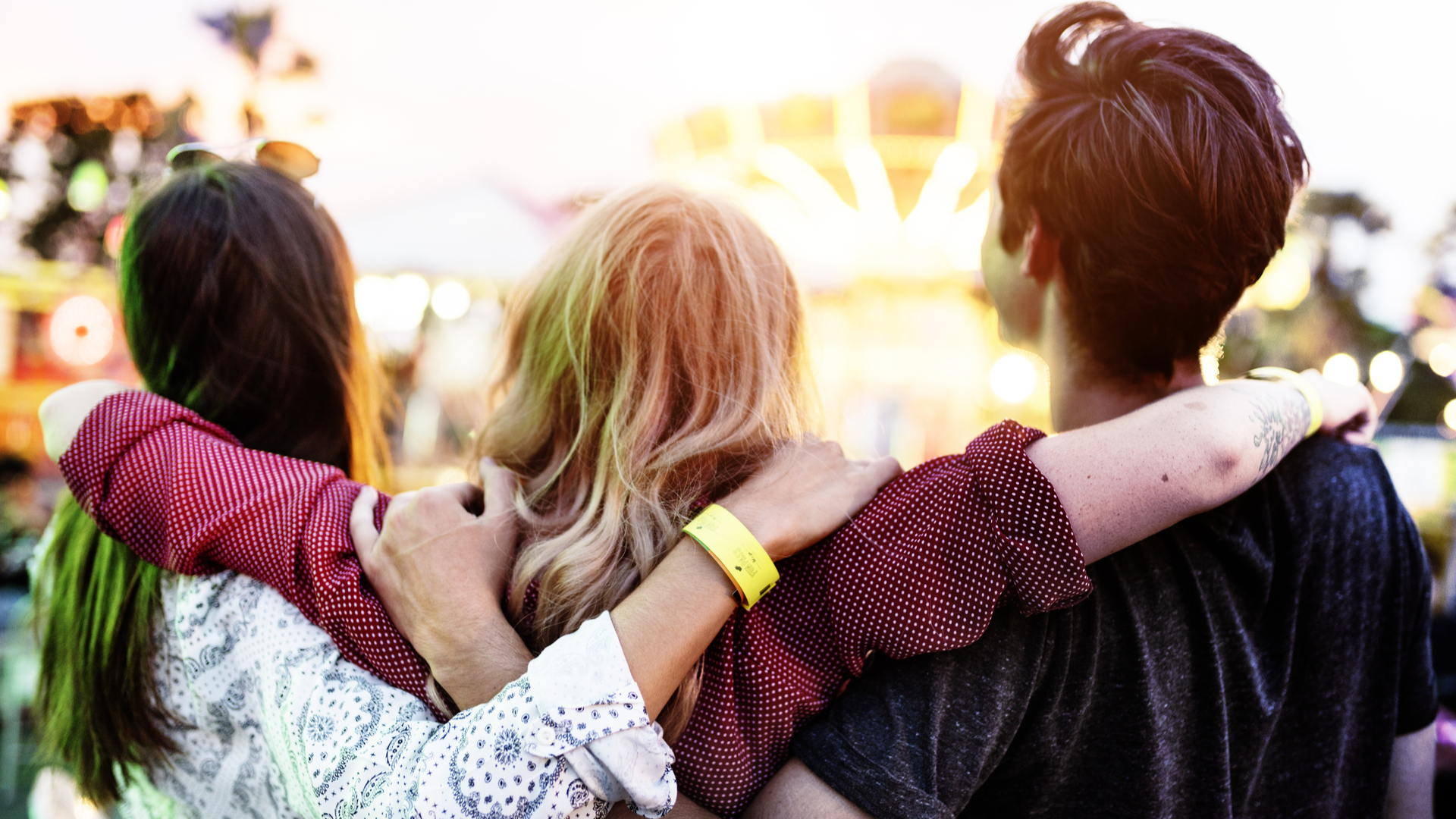 Three people linking arms