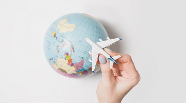 Photo of a globe and a toy plane