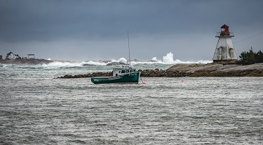 A fishing boat floats near the shore.