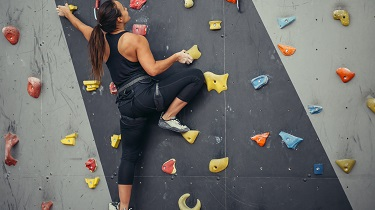 A woman at a climbing gym